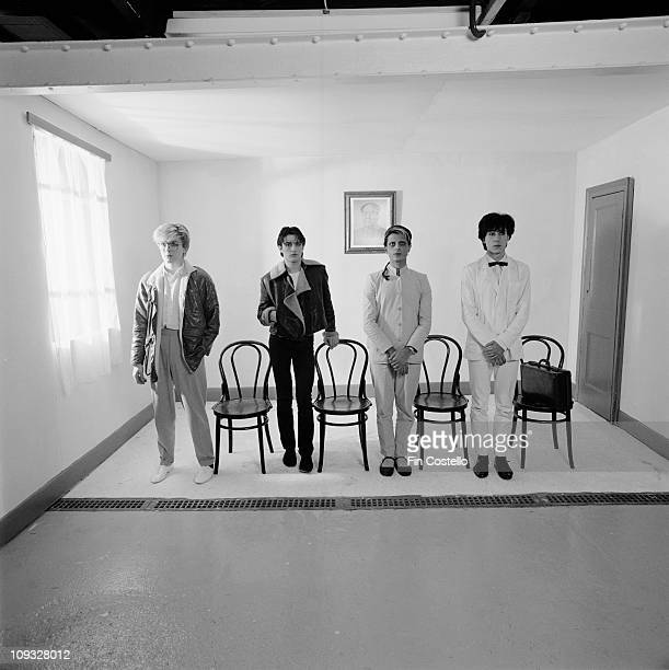 English band Japan posed standing by chairs with a portrait of Chairman Mao behind during the Tin Drum sessions in London in September 1981 LR David...
