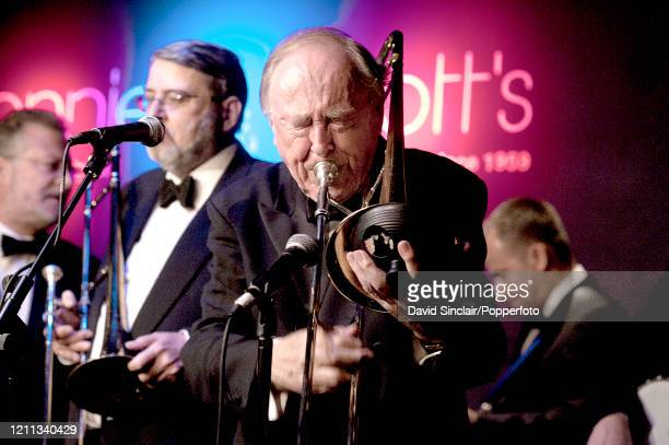 English bandleader and trombone player Chris Barber performs live on stage with the Chris Barber Big Band at Ronnie Scott's Jazz Club in Soho London...