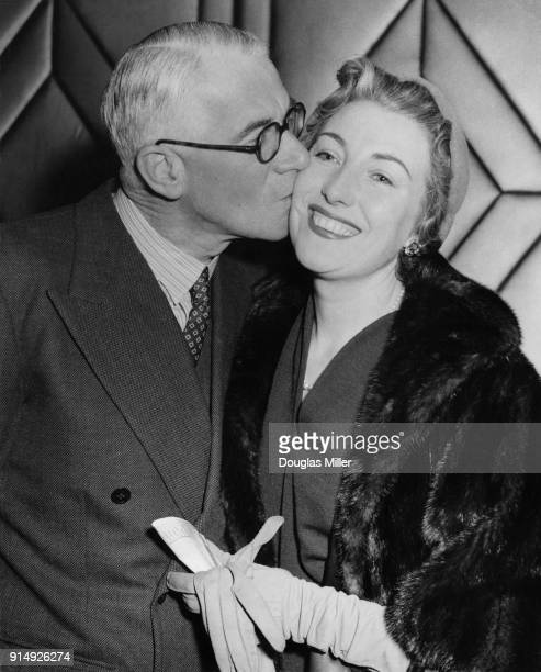 English bandleader Henry Hall kisses singer Vera Lynn during a Foyles Literary Luncheon at the Dorchester Hotel in London, to mark the publication of...