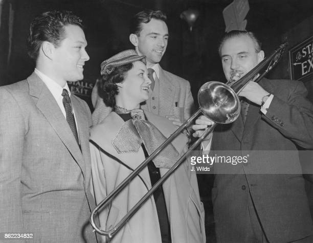 English bandleader Ted Heath and his singers perform at a reception in their honour at the Prince of Wales Theatre London 4th March 1954 They are...