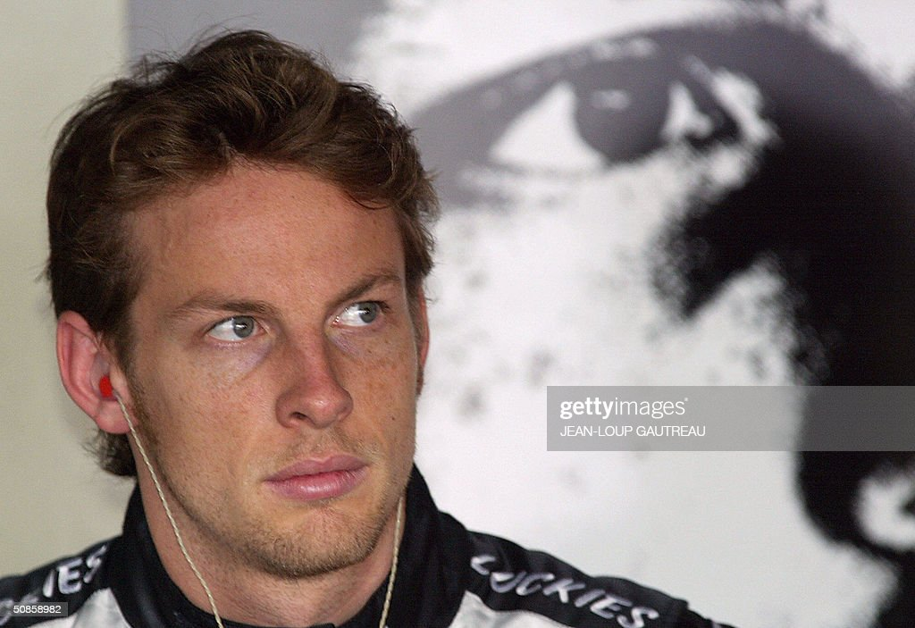 English BAR-Honda driver Jenson Button watches a control screen in the pits of the Monte-Carlo racetrack during the first free practice session three days before the Monaco Grand Prix, 20 May 2004 in Monaco.