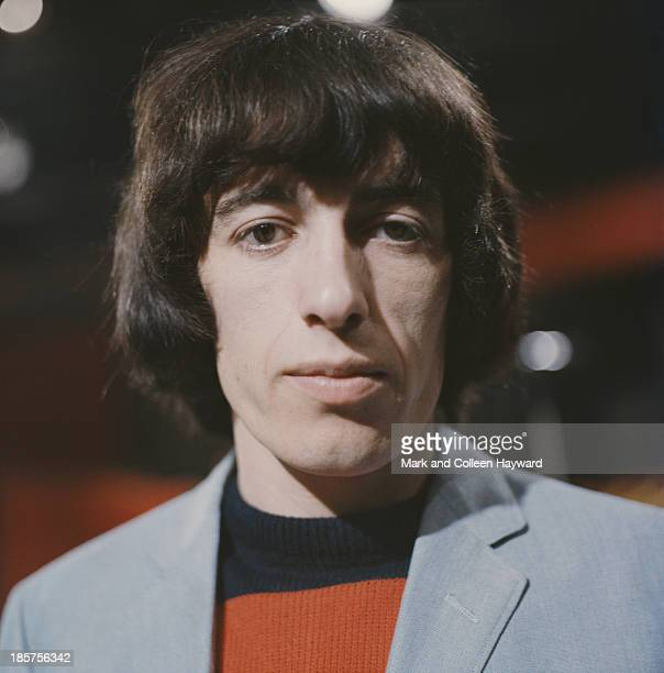 English bass guitarist and member of The Rolling Stones Bill Wyman posed circa 1964