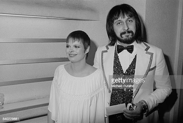 English bass guitarist John Entwistle of The Who with his wife Alison at the premiere of Ken Russell's film version of The Who's rock opera 'Tommy'...