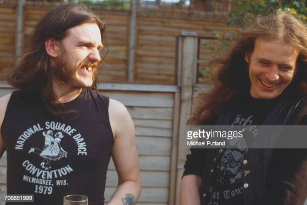 English bassist and singer Ian 'Lemmy' Kilmister pictured with guitarist 'Fast' Eddie Clarke of heavy rock group Motorhead in London in 1982