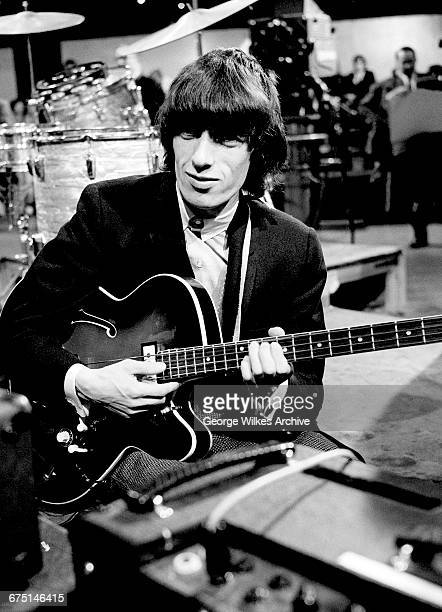 English bassist Bill Wyman of The Rolling Stones during rehearsals for an episode of the Friday night TV pop/rock show 'Ready Steady Go' at...