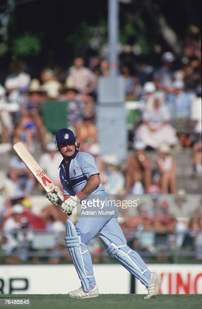English batsman Allan Lamb makes a run during a match against the West Indies in the Benson Hedges World Series at Brisbane Australia 1987