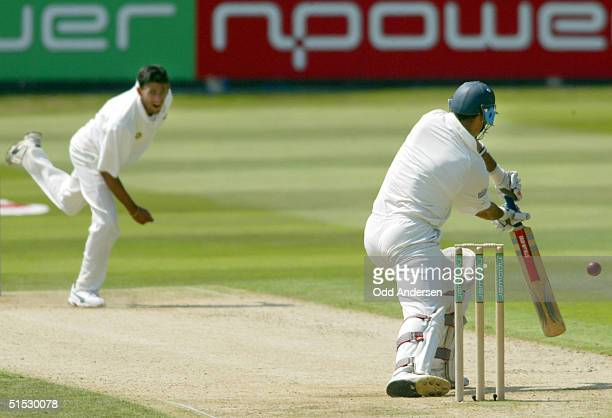 English batsman and captain Nasser Hussain hits a ball delievered by Indian bowler Ajit Agarkar to be caught by Indian wicket keeper Ajay Ratra for...