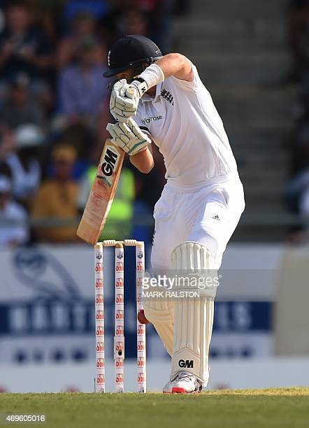 English batsman Joe Root misses his shot and is bowled by Jerome Taylor for 83 during day one of the first test match between West Indies and England...