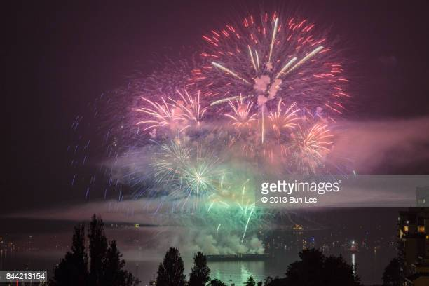 english bay, vancouver, august 2nd, 2017: celebration of light - firework - english bay stock photos and pictures