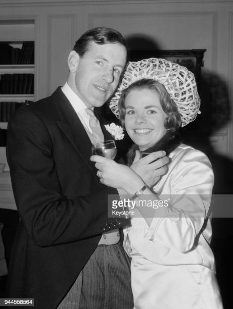 English BBC television announcer Judith Chalmers and her husband Neil Durden-Smith toast each other at their wedding reception at the Ski Club of...