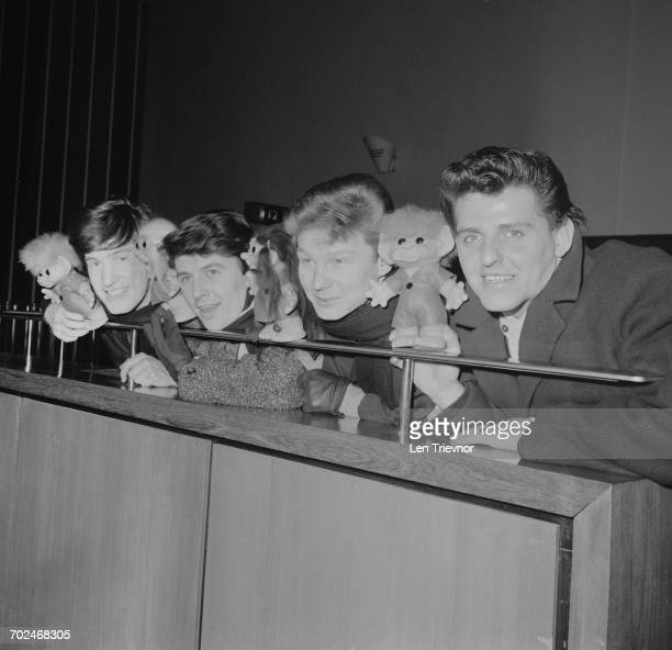 English beat group The Searchers holding troll dolls or 'gonks' UK 19th February 1964 From left to right drummer Chris Curtis guitarist Mike Pender...