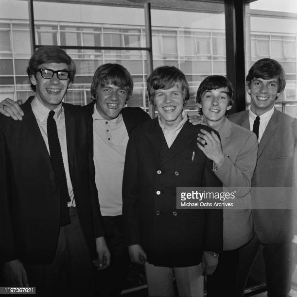 English beat rock band Herman's Hermits at London Airport UK 1966 From left to right guitarist Derek Leckenby bass player Karl Green singer Peter...