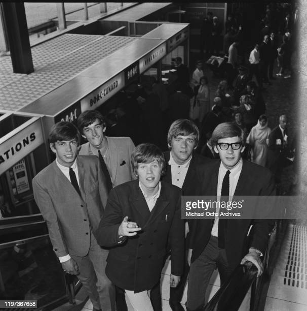 English beat rock band Herman's Hermits at London Airport UK 1966 From left to right drummer Barry Whitwam guitarist Keith Hopwood singer Peter Noone...