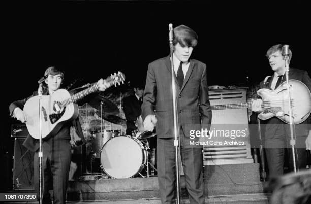 English beat rock band Herman's Hermits perform at the Peppermint Lounge in New York City circa 1965 From left to right they are rhythm guitarist...