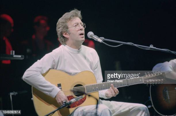 English blues guitarist and singer Eric Clapton performs live on stage playing acoustic guitar at the Royal Albert Hall in London during the Nothing...