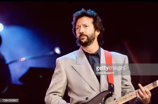 English Blues musician Eric Clapton performs onstage during Nelson Mandela's 70th birthday tribute concert at Wembley Stadium, London, 6/11/1988.
