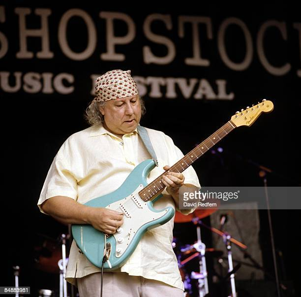 English blues singer and guitarist Peter Green performs live on stage playing a blue Fender Stratocaster guitar at the Bishopstock Blues Festival at...