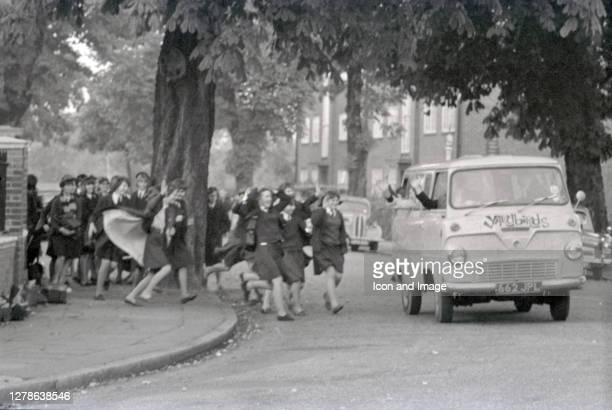 English blues-rock band The Yardbirds being chased by a gaggle of rabid female fans, in London, UK, circa 1964.