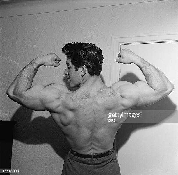 English bodybuilder Reg Park flexes his biceps circa 1955 Park was the first Englishman to win the Mr Universe title and later went on to act in five...