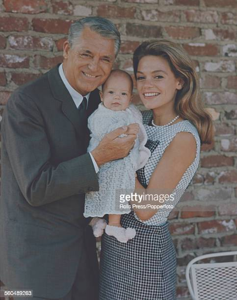 English born actor Cary Grant pictured with his wife Dyan Cannon and baby daughter Jennifer Grant in the United States in June 1966