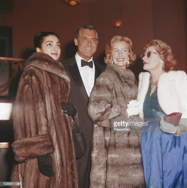 English born American actor Cary Grant pictured with author Fleur Cowles and actresses Kamala Devi and costar Dina Merrill at the premiere of the...