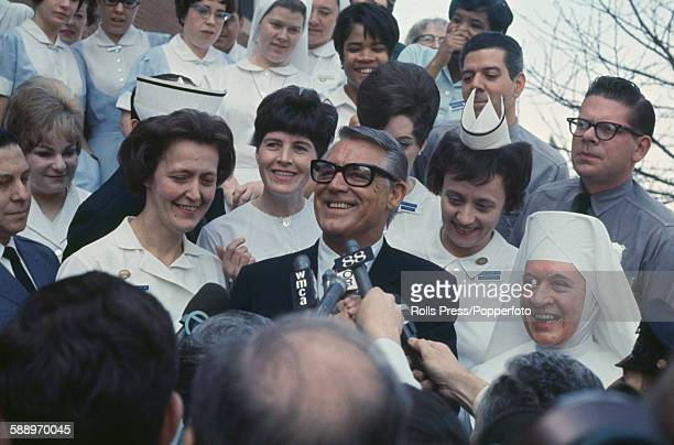 English born American actor Cary Grant pictured with nurses and members of staff as he leaves Saint John's Hospital in New York on 28th March 1968...