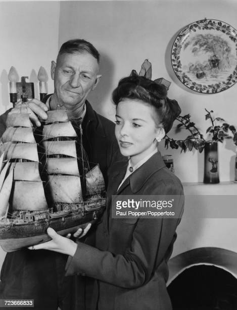 English born American actress Ida Lupino is presented with a ship's model by Louis Madsen in Hollywood Los Angeles during the making of the film 'The...