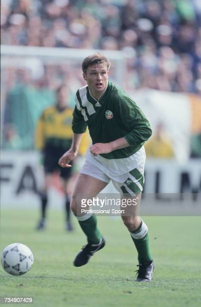 English born footballer and defender with the Republic of Ireland team Alan Kernaghan prepares to pass the ball during the FIFA World Cup group 3...
