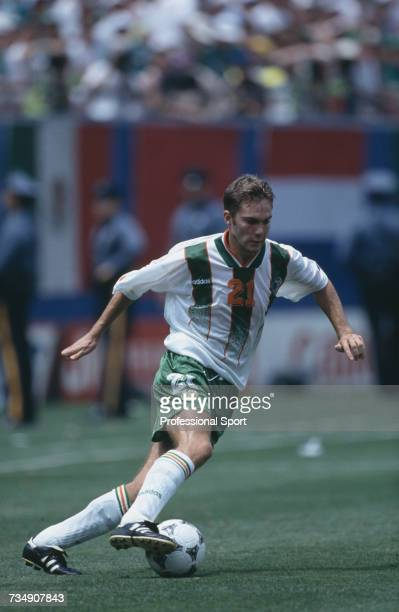English born footballer and midfielder with the Republic of Ireland team Jason McAteer pictured making a run with the ball during the 1994 FIFA World...