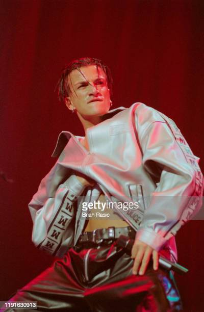 English born singer Peter Andre performs live on stage at the Top of the Pops Weekend Festival at Wembley Arena in London on 14th September 1996.