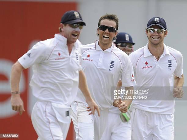 English bowler Graeme Swann celebrates with teammates after taking the wicket of West Indies batsman Ramnaresh Sarwan, caught Paul Collingwood ,...