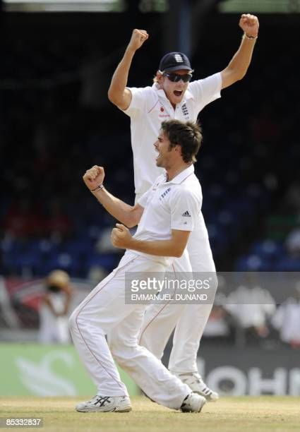 English bowler James Anderson celebrates with Stuart Broad after taking the wicket of West Indies batsman Brendan Nash, during the fifth and final...