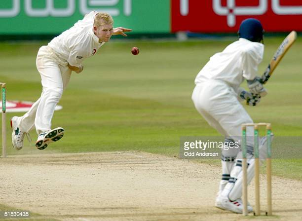 English bowler Mathew Hoggard makes a delivery to Indian batsman Ajit Agarkar during a testmatch at Lord's cricket ground in London 29 July 2002...