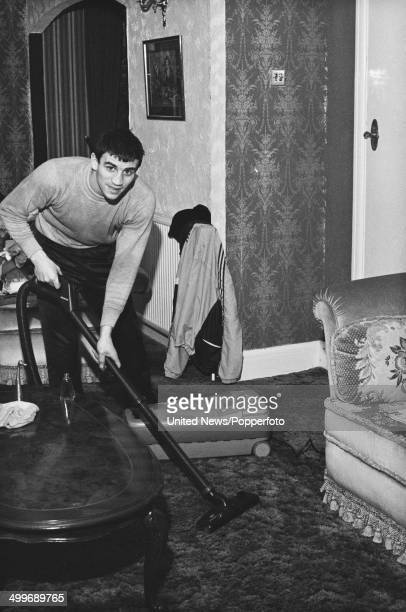 English boxer Charlie Magri posed operating a vacuum cleaner on the floor of a living room in London on 29th January 1985