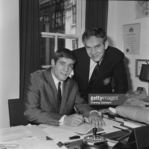 English boxer Mark Rowe and Polish boxer, matchmaker, manager and promoter Mickey Duff , UK, 22nd October 1968.