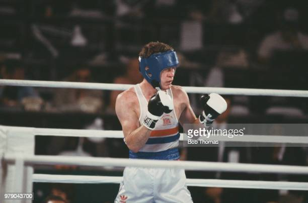 English boxer Mickey Hughes pictured in action for Great Britain to finish in 17th place in the Men's Welterweight boxing event at the 1984 Summer...