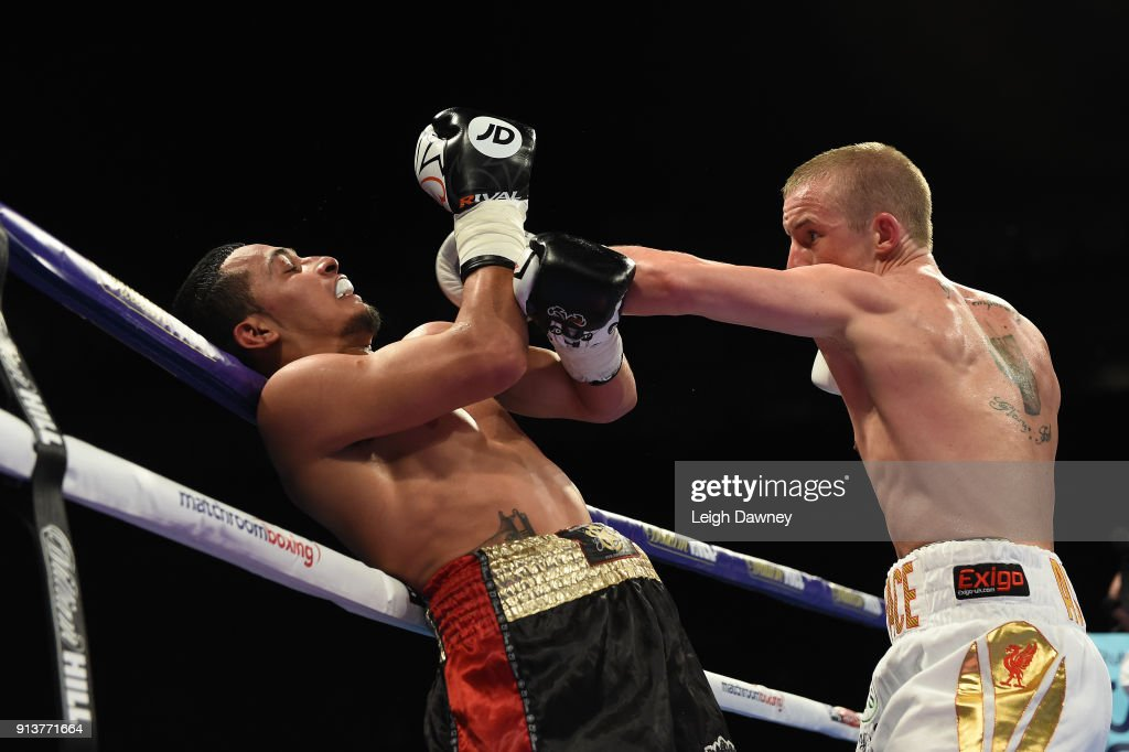 English boxer Paul Butler (r) in boxing action against Ecuadorian boxer Jefferson Vargas in a Super-Bantamweight contest at The O2 Arena on February 3, 2018 in London, England.