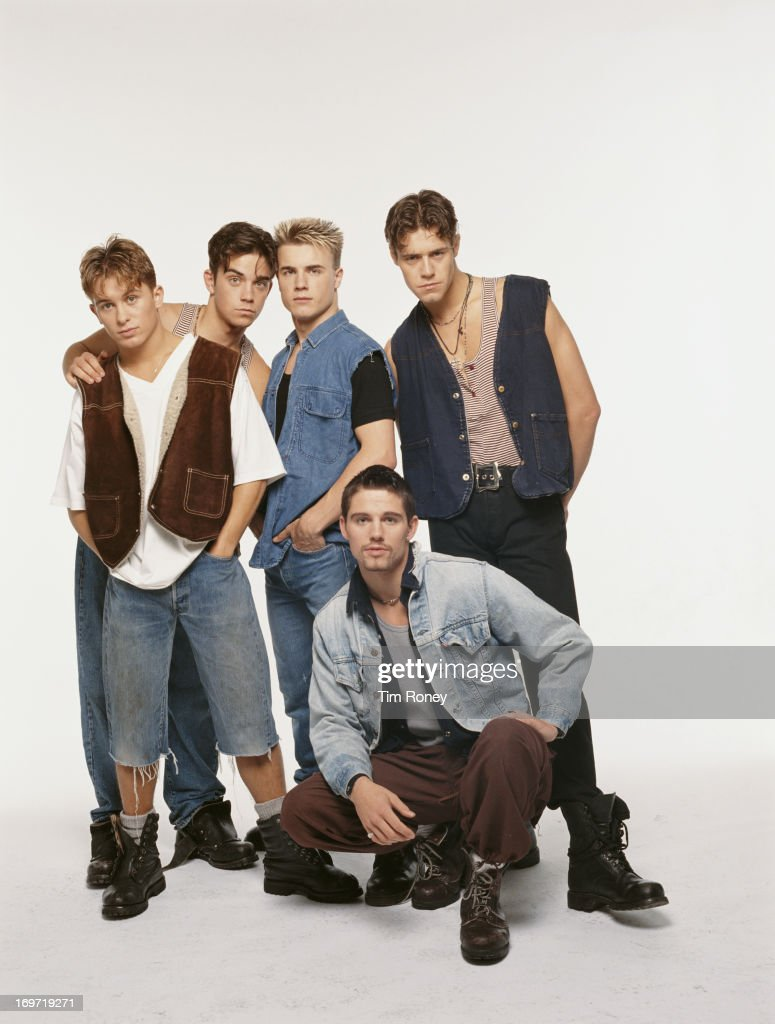 English boy band Take That, circa 1992. Left to right: Mark Owen, Robbie Williams, Gary Barlow, Jason Orange (crouching) and Howard Donald.