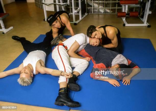 English boy band Take That, portrait in gym, United Kingdom, 1991. L-R Gary Barlow, Robbie Williams, Jason Orange, Howard Donald, Mark Owen.