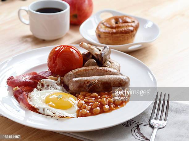 English breakfast with a cup of coffee and baked good