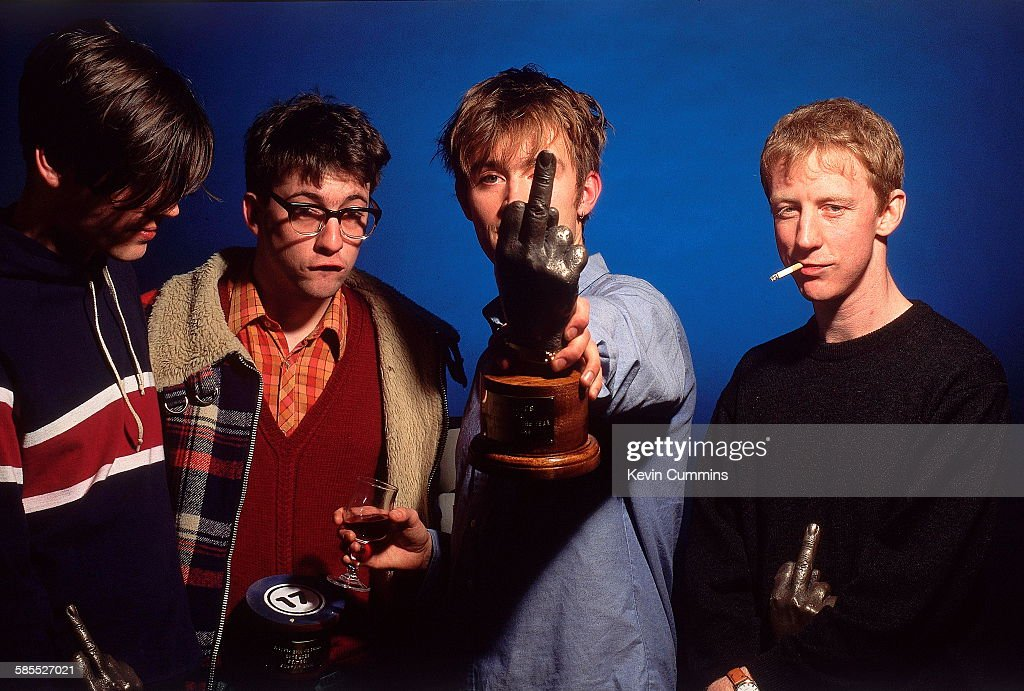 English Britpop band, Blur at the NME Brat Awards, London, February 1995. The group were presented with four awards at the event. Left to right: bassist Alex James, guitarist Graham Coxon, singer Damon Albarn and drummer Dave Rowntree.