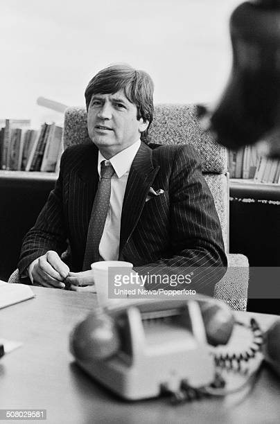 English broadcaster and Head of Arts programming at London Weekend Television Melvyn Bragg pictured sitting at his desk in the South Bank Television...