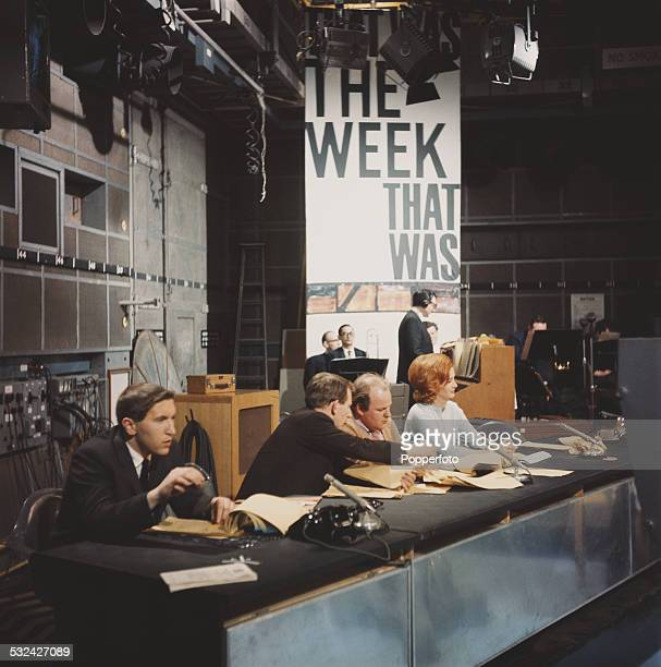 English broadcaster and journalist David Frost sits behind a desk with fellow presenters Lance Percival Roy Kinnear and Millicent Martin on the set...
