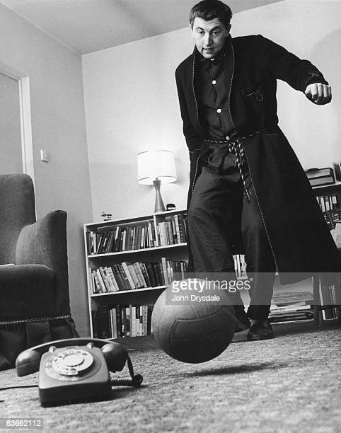 English broadcaster and satirist David Frost playing football in his flat 28th December 1962