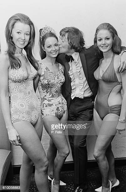 English broadcaster Michael Parkinson with contestants from the beauty contest 'The Most Wanted Woman on Earth' or 'Lady Du Pont' 11th July 1971 The...