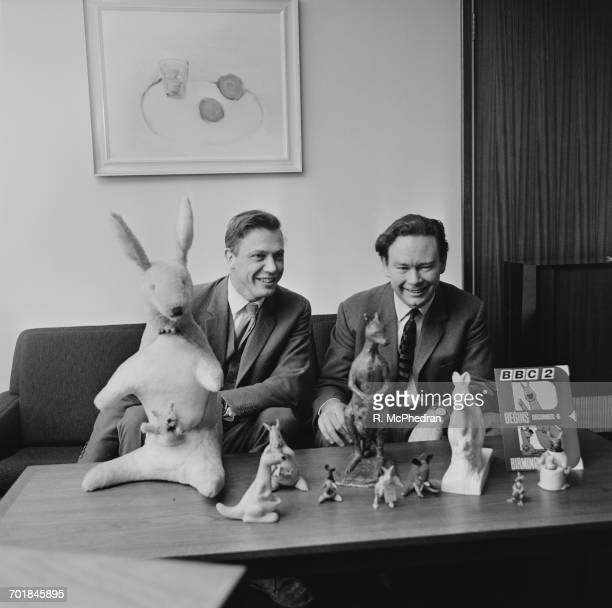 English broadcaster naturalist and newlyappointed controller of BBC Two David Attenborough and his predecessor Michael Peacock with soft toy versions...