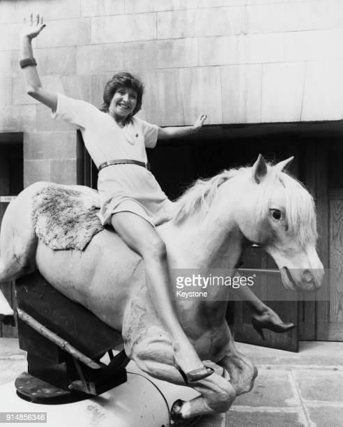 English broadcaster Sue Lawley riding a mechanical horse outside Broadcasting House in London 4th June 1980 The horse was featured on Lawley and...