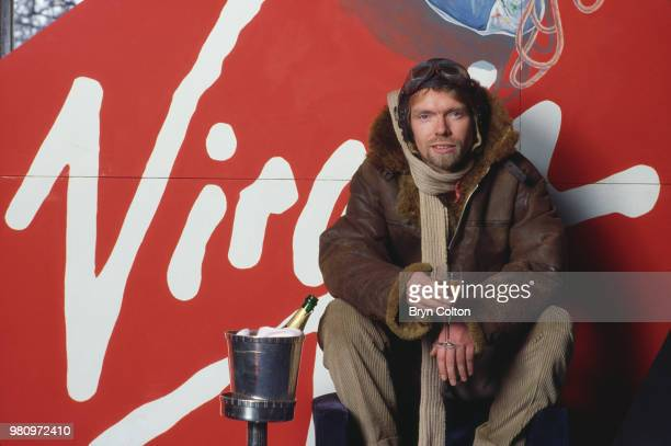 English business magnate, investor and philanthropist Richard Branson, co-founder of Virgin Atlantic Airways, poses in leather flying jacket and...