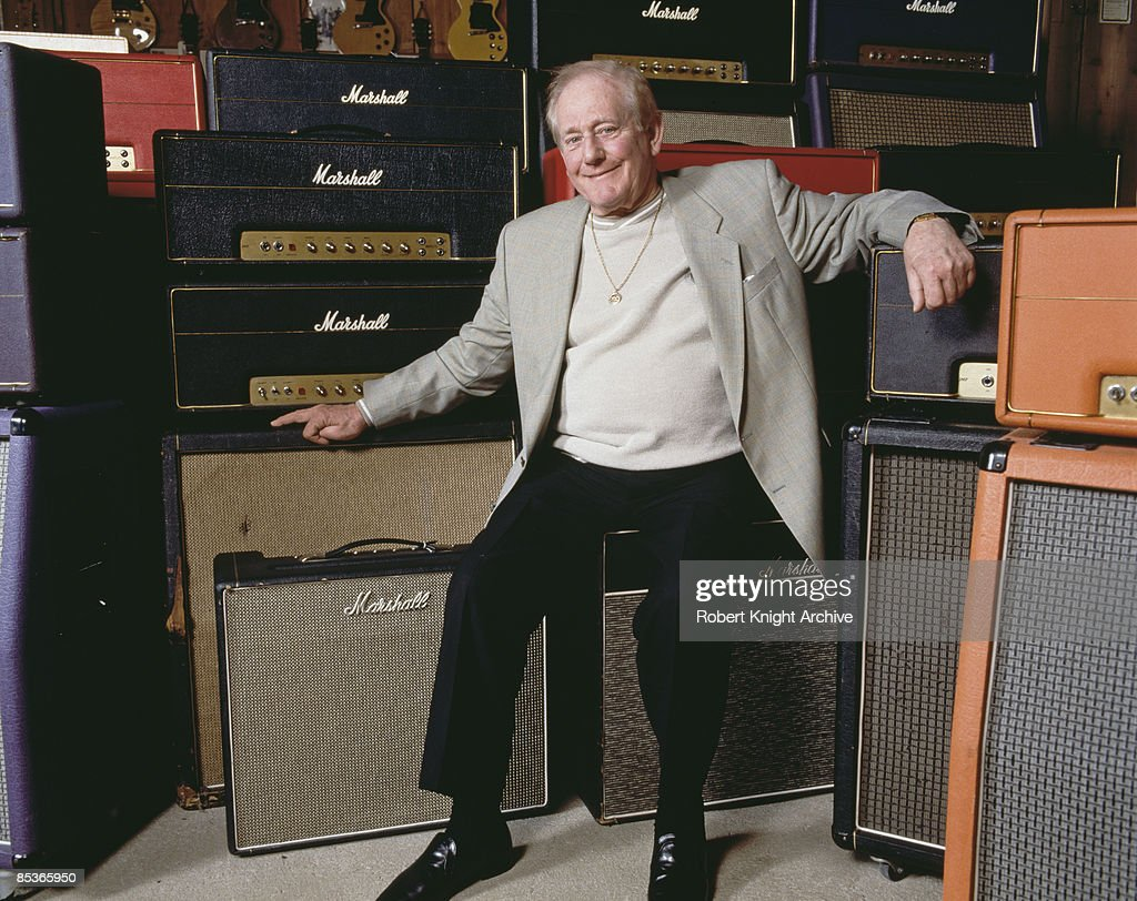 English businessman, and founder of Marshall Amplification, Jim Marshall (1923 – 2012) with a selection of his amplifiers, Los Angeles, California, 2000.