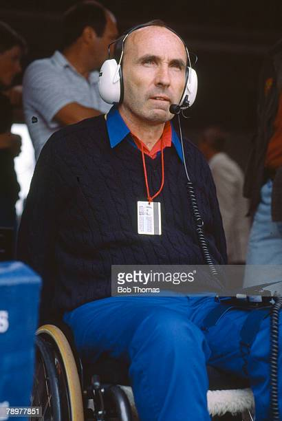 English businessman and head of the Williams Formula One racing team, Frank Williams pictured observing the action at a motor racing circuit circa...
